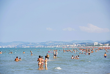 Tourists bathing in the sea, town of Ancona at the back, Senigallia, Province of Ancona, Marche, Italy, Europe