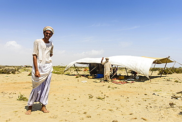 Rashaida man standing in front of his tent in the desert around Massaua, Eritrea, Africa