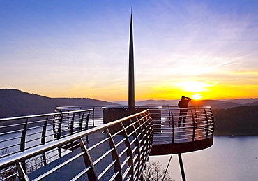 Viewing platform Biggeblick with a person at sunset, Biggesee reservoir, Attendorn, Sauerland, North Rhine-Westphalia, Germany, Europe