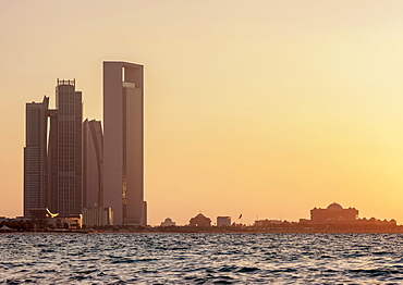 Skyline with Etihad Towers and Emirates Palace Hotel at sunset, Abu Dhabi, United Arab Emirates, Asia
