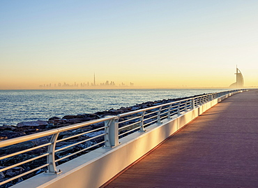 Palm Jumeirah Boardwalk and City Centre Skyline at sunrise, Dubai, United Arab Emirates, Asia