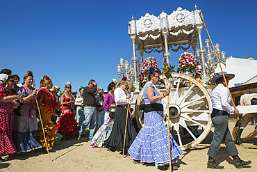 People in traditional clothes and decorated oxcarts, Pentecost pilgrimage of El Rocio, Huelva province, Andalusia, Spain, Europe