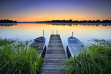 Dawn at the lake Grosser Mullroser See, wooden footbridge with rowboats, Mullrose, nature park Schlaubetal, Brandenburg, Germany, Europe