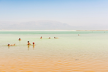 People bathing in the Dead Sea, Ein Bokek Beach, Dead Sea, Kalia Beach, Israel, Asia
