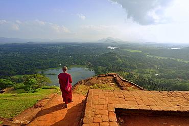 Buddhist nun enjoying the view from the ruins of the fortress on the Lion Rock, Sigiriya, UNESCO World Heritage Site, Sigiriya, Central Province, Sri Lanka, Asia