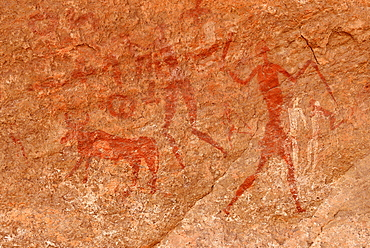 Neolithic rock art, rock painting of cows, bulls and warriors, Bovidian period, Tadrart, Tassili n'Ajjer National Park, Unesco World Heritage Site, Algeria, Africa