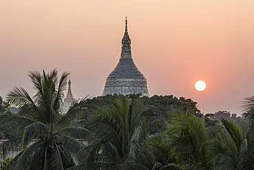 Sunset, pagoda surrounded by trees, Sagaing Region, Myanmar, Asia