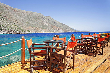 Cafe terrace on the harbour promenade, Loutro, South Crete, Crete, Greece, Europe