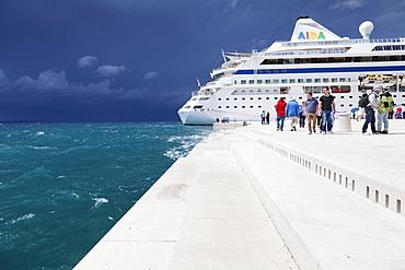 Sea Organ with a cruise ship, with impending thunderstorm, Zadar, Dalmatia, Croatia, Europe