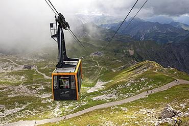 Cable car, Nebelhornbahn cabin, Hofatsblick and Edmund Probst Haus stations in the back, Allgau Alps, Oberstdorf, Oberrallgau, Allgau, Bavaria, Germany, Europe