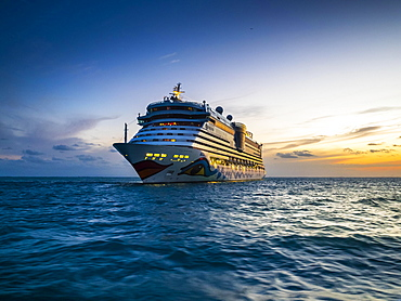 Cruise ship Aidaluna off the coast, sunset, Belize, Central America