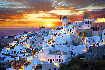 Townscape with windmills at sunset, Oia, Santorini, Cyclades, Greece, Europe