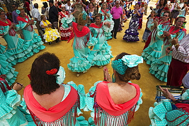 Women wearing gypsy dresses perform traditional Andalusian dances at the Feria del Caballo, Jerez de la Frontera, Cadiz province, Andalusia, Spain, Europe