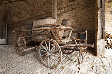 Old hay cart with wine barrels in the courtyard of a wine press, 19th century, Franconian Open Air Museum of Bad Windsheim, Middle Franconia, Bavaria, Germany, Europe
