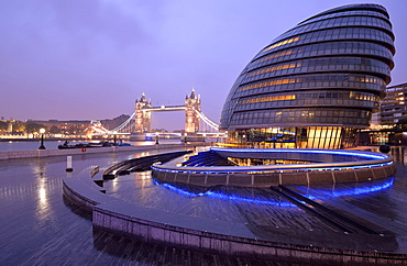 City Hall designed by Sir Norman Foster, Tower Bridge at the back, at dusk, London, England, United Kingdom, Europe