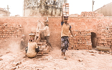 Workers with bricks on their heads in the brickyard, Dhaka, Bangladesh, Asia