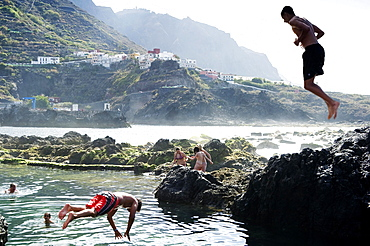 Swimming fun, lava coast near Garachico, Tenerife, Canary Islands, Spain, Europe