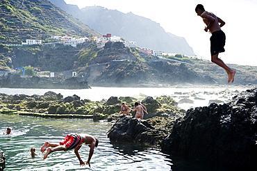 Swimming fun, lava coast near Garachico, Tenerife, Canary Islands, Spain, Europe