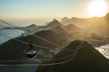 View from the Sugarloaf Mountain or Pao de Acucar and the famous cable car, at sunset, Rio de Janeiro, Brazil, South America