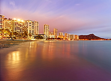 Waikiki Beach at dusk, Honolulu, Oahu, Hawaii, United States, North America
