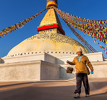 A man walking around Boudhanath stupa, Boudhanath, Kathmandu, Kathmandu District, Bagmati Zone, Nepal, Asia