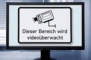 """Sign """"Dieser Bereich wird videoueberwacht"""", German for """"this area is under video surveillance"""", on a computer screen"""