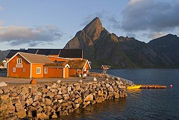 Rorbuer huts, rorbu, of the tiny village Sakrisoy, Sakrisoy, mountains at back, island of Moskenesoy, Moskenesoy, Lofoten archipelago, Nordland, Norway, Europe