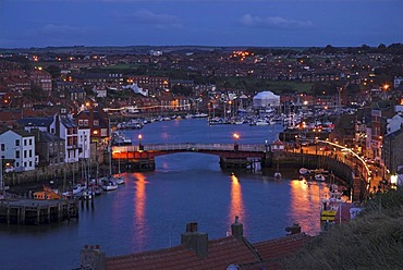 Bridge crossing River Esk in Whitby at the blue hour, Yorkshire, United Kingdom, Europe