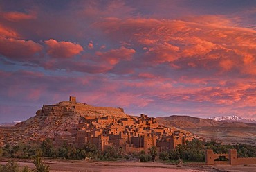 A spectacular sunrise above the Ksar, fortified city, of Ait Ben Haddou, UNESCO World Heritage Site, and the Ounila River on the eastern slope of the High Atlas mountains, Souss-Massa-Draa, Morocco, Africa