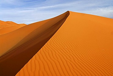 Patterns of sand and shadow on the sand dunes of Erg Chebbi in evening light, at the western edge of the Sahara desert, Meknes-Tafilalet, Morocco, Africa