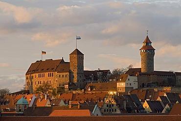 The Imperial Castle (Kaiserburg) of Nuremberg illuminated by warm evening light, Nuremberg, Middle Franconia, Bavaria, Germany, Europe