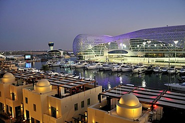 Yas Hotel and marina at the Formula One racetrack Yas Marina Circuit on Yas Island in the last daylight, Abu Dhabi, United Arab Emirates, Arabia, Asia
