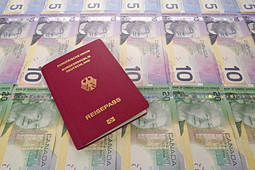 Passport of the Federal Republic of Germany and various Canadian dollar banknotes