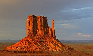 West Mitten Butte in the last light of the day during a thunderstorm, Monument Valley, Arizona, USA