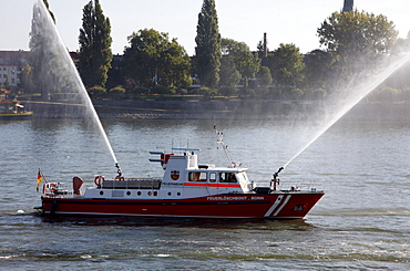 Fire fighting boat of the Bonn fire brigade on the Rhine with water jets from two cannon during a display, Bonn, North Rhine-Westphalia, Germany, Europe
