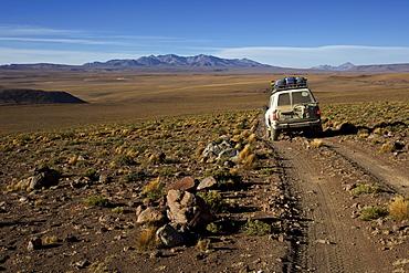 Off-road vehicle on a gravel road, Atacama Desert, Altiplano, southern Bolivia, South America