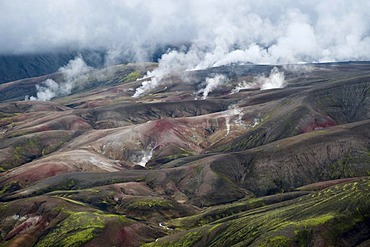 Hot springs emerging from the colourful volcanic landscape near Reykjadalir and Hrafntinnusker, first and second day's stage of the popular hiking trail of Laugavegur, Iceland, Europe