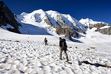 Climbers during the ascent to Piz Palue Mountain on the Pers Glacier, looking towards Piz Palue Mountain, with Bellavista on the left, Grisons, Switzerland, Europe