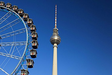 Fernsehturm television tower and Ferris wheel against a blue sky, Berlin, Germany, Europe, PublicGround