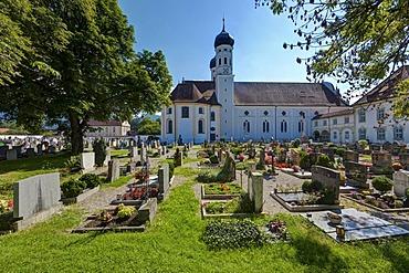Church and cemetery of Benediktbeuern Abbey, a former Benedictine abbey, today a monastery of the Salesians of Don Bosco in Benediktbeuern, diocese of Augsburg, Benediktbeuern, Upper Bavaria, Bavaria, Germany, Europe