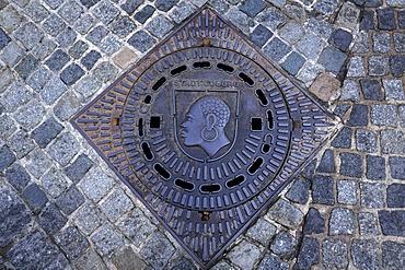 "St. Mauritius, ""Coburg Moor"", patron saint of Coburg on a manhole cover, Coburg, Upper Franconia, Germany, Europe"