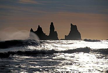 Reynisdrangar group of rocks near Vik i M˝rdal with Skessudrangur, Laddrangur and Langhamar rock formations, according to legend, three petrified trolls, south coast, Iceland, Europe