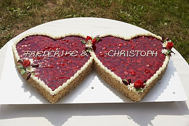 Wedding cake with strawberries in the shape of two hearts