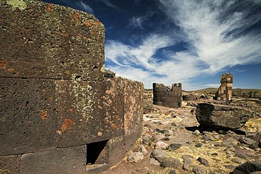 Burial towers called chullpas, of the Aymara people from the Colla culture above Lake Umayo near Puno, conquered by the Incas in the 15th Century and reused, Puno, Peru, South America