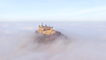 Burg Hohenzollern castle in morning light, early morning fog, Swabian Alb, Baden-Wuerttemberg, Germany, Europe