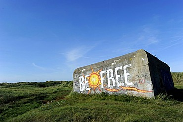 """Old bunker in the dunes, with the graffiti """"Be Free"""", Fano island, Denmark, Scandinavia, Europe"""