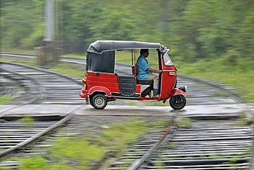 Three-wheeler in heavy rain, railway crossing in Kalawewa, Sri Lanka, Ceylon, South Asia, Asia, PublicGround