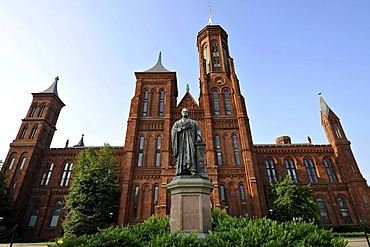"""Statue of scientist Joseph Henry in front of the Smithsonian Institution Building, admin and museum building, known as """"the Castle"""", National Mall, Washington DC, District of Columbia, United States of America, USA, PublicGround"""