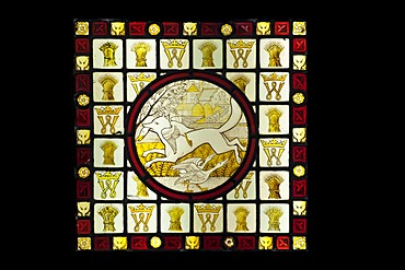 Stained glass roundel surrounded by quarries, depicting a fox and a goose, a scene from Reynard and the fox, designed and made by Clement James Heaton between about 1845-1855, Stained Glass Museum in Ely Cathedral, Ely, England, United Kingdom, Europe