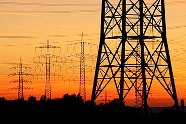 High voltage transmission lines, power lines, sunset, between Essen, Bottrop and Oberhausen, North Rhine-Westphalia, Germany, Europe